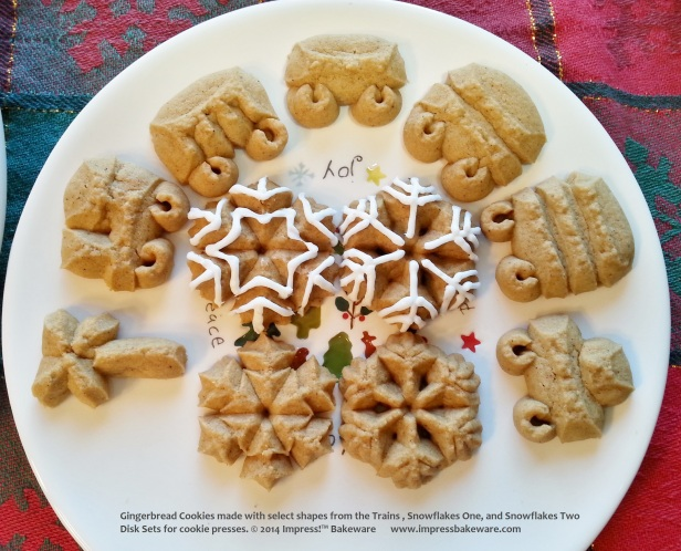 Gingerbread Cookies made with select shapes from the Trains , Snowflakes One, and Snowflakes Two Disk Sets for cookie presses. © 2014 Impress!™ Bakeware