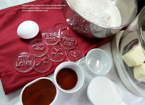 Valentine's Day Cookie Press disks and ingredients for almond spritz cookies © 2015 Impress! Bakeware™