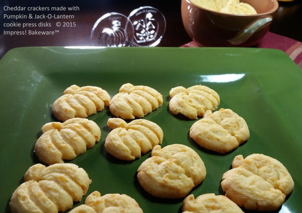 Cheddar crackers made with Pumpkin & Jack-O-Lantern cookie press disks © 2015 Impress! Bakeware™