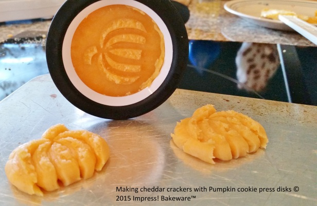Making cheddar crackers with Pumpkin cookie press disks © 2015 Impress! Bakeware™