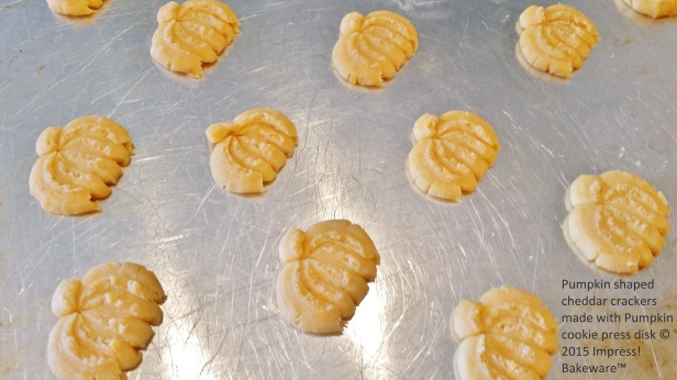 Pumpkin shaped cheddar crackers made with Pumpkin cookie press disk © 2015 Impress! Bakeware™