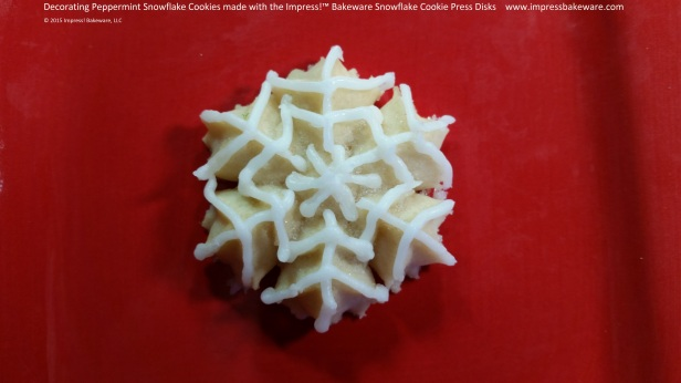 Decorating Peppermint Snowflake Cookies made with the Impress!™ Bakeware Snowflake Cookie Press Disks © 2015 Impress! Bakeware, LLC