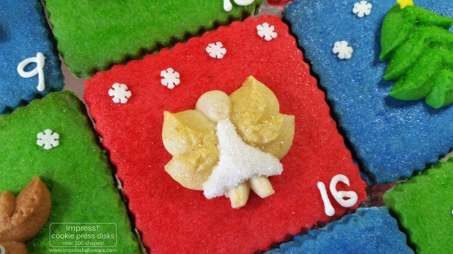 Advent Calendar Cookie Display Almond Spritz © 2016 Impress! Bakeware, LLC cookie press Angel with gold wings p - Copy.jpg
