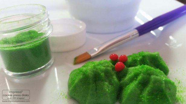 Making Holly Leaves Spritz Cookies © 216 Impress! Bakeware, LLC cookie press e.jpg