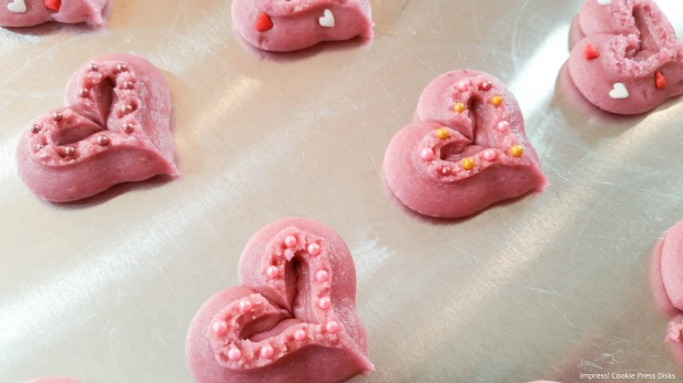 hh2 Raspberry Thumbprint Valentine's Spritz Cookies cookie press w © 2018 Impress! Bakeware, LLC.jpg