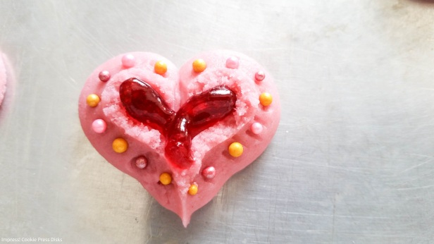kk Raspberry Thumbprint Valentine's Spritz Cookies cookie press w © 2018 Impress! Bakeware, LLC.jpg