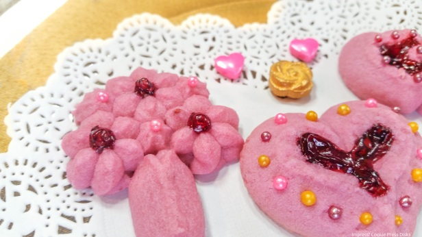 y Raspberry Thumbprint Valentine's Spritz Cookies cookie press w © 2018 Impress! Bakeware, LLC.jpg